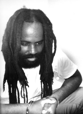 http://sfbayview.com/wp-content/uploads/2009/06/mumia-bw-contemplative-by-prison-radio.jpg