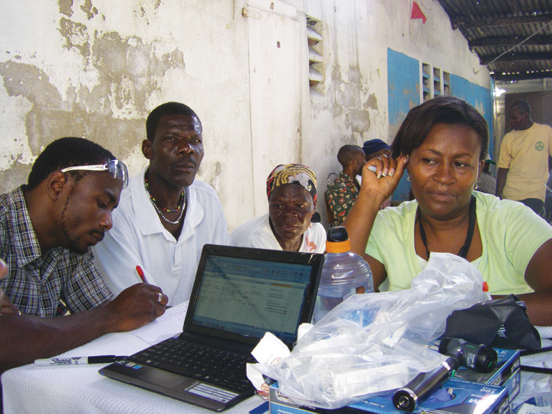 Haiti-II-Sampson-left-Rea-rt-translate-for-medical-team-at-Cite-Soleil-mobile-clinic-0610-by-Dr.-Chris-Zamani1, Back to Port au Prince, World News & Views