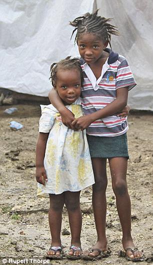 Haiti-rain-two-little-girls-by-c-Rupert-Thorpe, Opportunities are washing away in Haiti, World News & Views