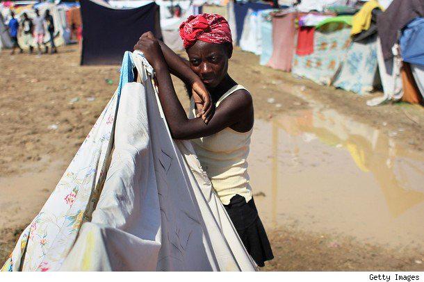Haiti-rain-woman-sheet-tent-0610-by-Getty, Opportunities are washing away in Haiti, World News & Views