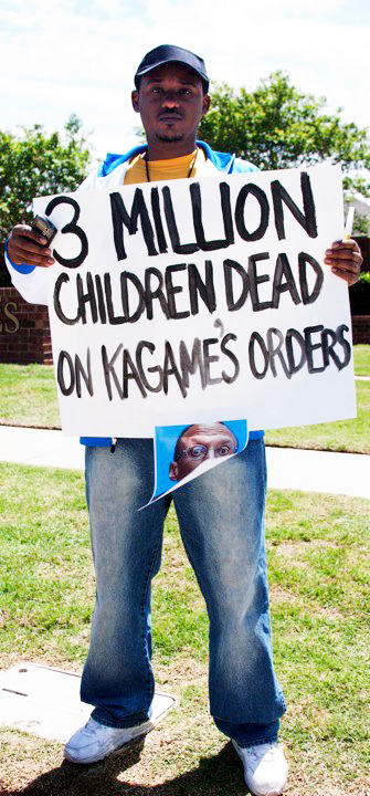 Anti-Kagame-protest-at-Okla.-Christian-Univ.-Claude-Gatebuke-3-mil-children-dead-sign-re-Congo-043010-by-Kendall-Brown, Kagame sworn in after U.N. report of guilt in Congo genocide, World News & Views