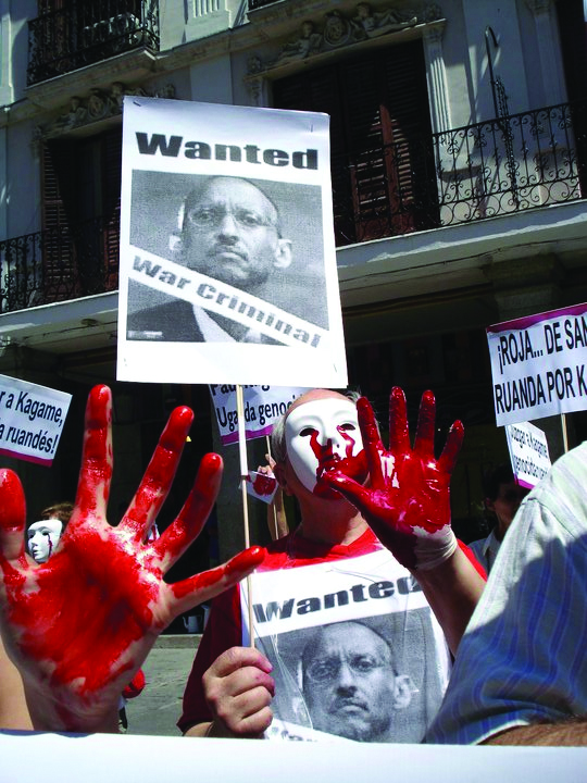 Anti-Kagame-protest-in-Spain-'bloody'-hands-0710, Kagame sworn in after U.N. report of guilt in Congo genocide, World News & Views