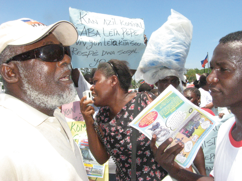 Haiti-Aug-12-protest-passing-out-comic-books-leaflets-081210-by-Wanda, Wanda in Haiti: Pain, protest, planning for the future, World News & Views