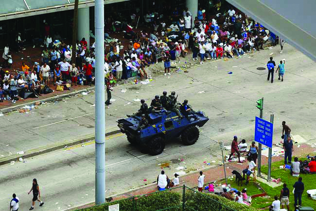 New-Orleans-Katrina-convention-ctr-police-stop-rescue-to-patrol-for-looters-by-MCT, After Katrina, New Orleans cops were told they could shoot looters, National News & Views