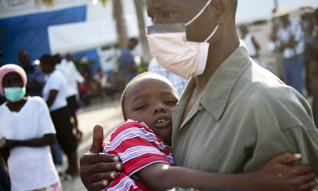 Haiti-cholera-man-holds-boy-102210-by-Andres-Martinez-Casares-EPA, Cholera epidemic: Foul drinking water killing Haitians, World News & Views