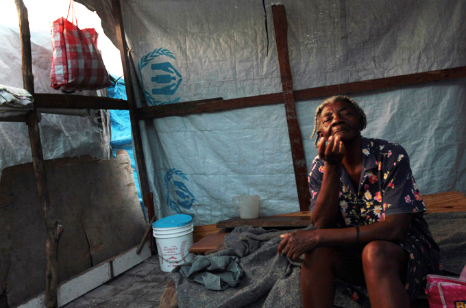 Haiti-elderly-woman-in-one-of-1300-PAP-camps-1010-by-Gallo-Getty, Nine months after the quake, a million Haitians slowly dying, World News & Views