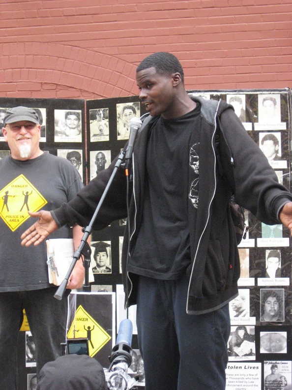 Norman-Curry-Anita-Gays-son-DAndre-Teeter-left-at-Oct.-22-rally-102210-by-Wanda, Police brutality decried by angry, grieving families, Local News & Views