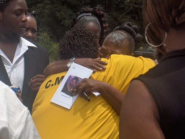 Jamie-Scott-hugs-mom-Evelyn-Rasco-as-Jamies-son-Terrance-looks-on-sad-return-to-unjust-imprisonment, Scott sisters to be freed! Gov. Barbour demands a kidney for their freedom, Behind Enemy Lines
