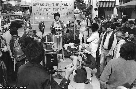 KPFA-broadcasts-from-street-archival-photo-by-Jeffrey-Blankfort, Pacifica Radio to broadcast news from Al Jazeera English, National News & Views