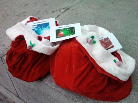 Santa-bags-with-Christmas-cards-urging-Mayor-Newsom-to-sign-local-hire-122310-by-SF-Bay-Guardian, Out-of-work San Franciscans descend upon City Hall with a special holiday request, Local News & Views