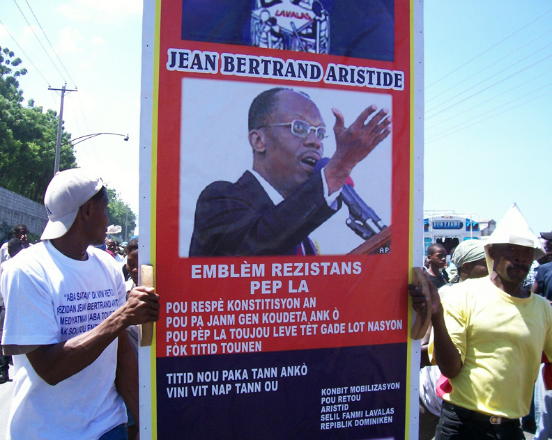 Aristide-symbol-of-resistance-093006-by-Wadner-Pierre3, If Duvalier can, why can't Aristide?, World News & Views
