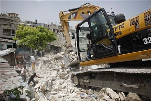 Haiti-rubble-removal-by-Ashbritt-0610, One year after Haiti earthquake, corporations profit while people suffer, World News & Views