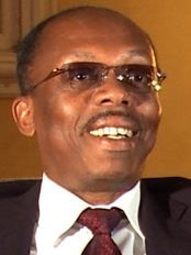 Jean-Bertrand-Aristide-smiling-by-Haiti-Libre, If Duvalier can, why can't Aristide?, World News & Views