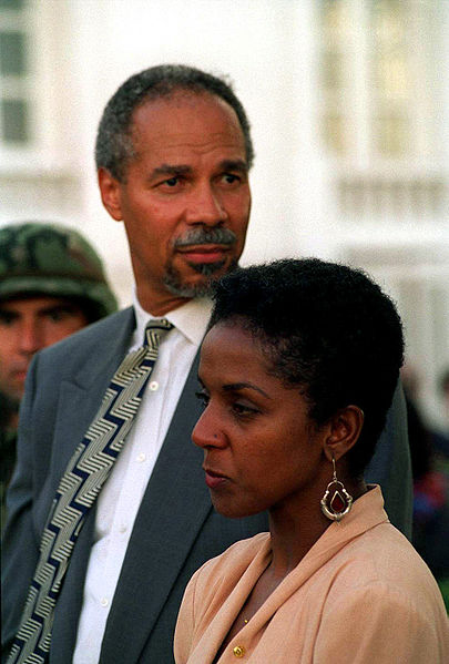 Randall-Robinson-wife-at-1994-Aristide-inauguration-following-hunger-strike-by-US-DOD, In memory of John Maxwell, Culture Currents
