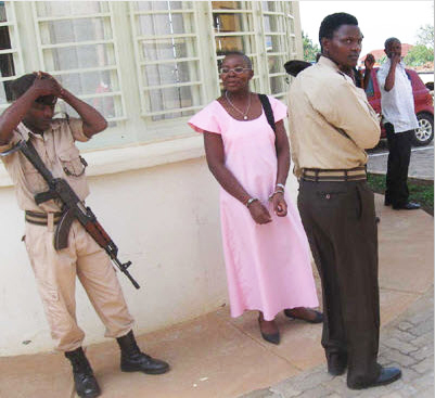 Victoire-Ingabire-led-from-prison-to-court-handcuffed-head-shaved-0111, Kagame court again denies bail to Victoire Ingabire, World News & Views