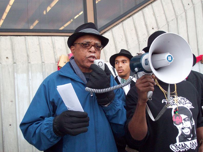 dad-at-Fruitvale-BART-010111-by-Judy-Greenspan, New Year's Day vigil commemorates Oscar Grant killing, Local News & Views