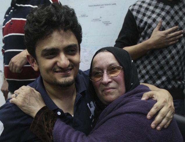 Egyptian-Wael-Ghonim-Google-Inc.s-marketing-mgr-hugs-mother-of-Khaled-Said-police-brutality-victim-021111-by-AP, Egypt revolution youth form national coalition, World News & Views