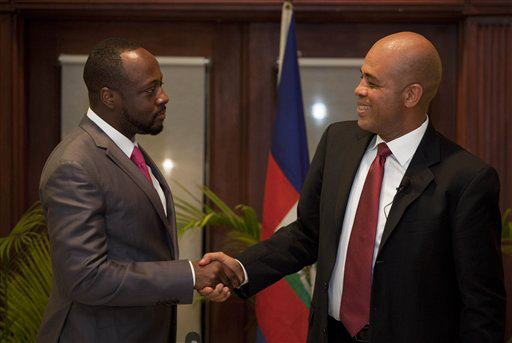 Haiti-election-Wyclef-Jean-endorses-Michel-Martelly-021611-by-Ramon-Espinosa-AP, Haiti: Annul the elections, World News & Views