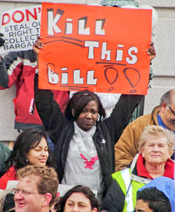Madison-Wisc.-Protester-'Kill-this-bill'-021611-by-Bryan-G.-Pfeifer-Workers-World, Tens of thousands liberate state Capitol in Madison, National News & Views