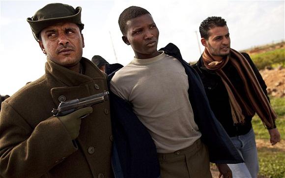 Anti-Gaddafi-militia-escort-suspected-mercenary-0311-by-AP, African refugees trapped in Libya, World News & Views
