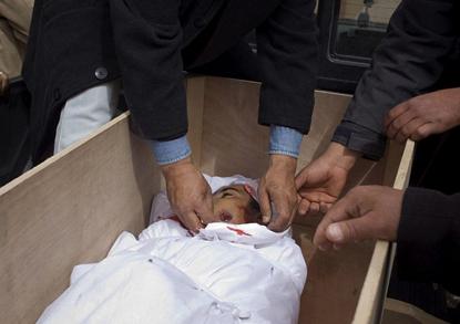 Libyan-child-killed-Brega-Libya-030911, Bombing Libya 1986-2011, World News & Views