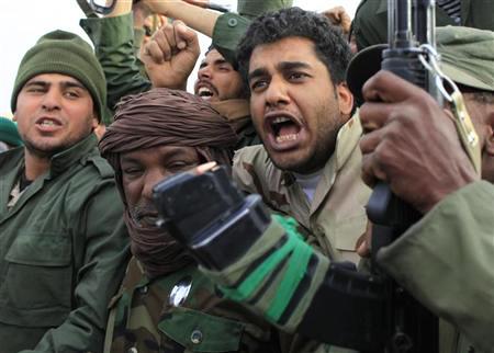 Libyan-gov't-soldiers-prepare-to-retake-Ajdabiya-031611-by-Ahmed-Jadallah-Reuters, U.S., NATO and the attacks against Libya, World News & Views