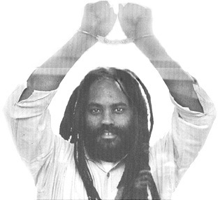 Mumia-handcuffed-hands-raised, Mumia Abu-Jamal's 1982 death sentence is again declared unconstitutional, Behind Enemy Lines