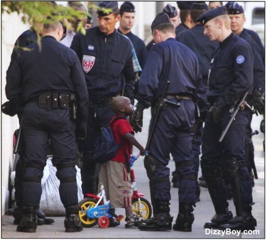 White_cops_surround_little_Black_boy1.jp