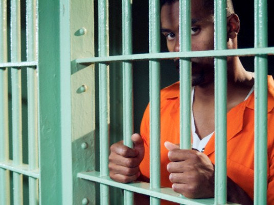 Black-man-in-prison-cell, Racial imprisonment, Behind Enemy Lines