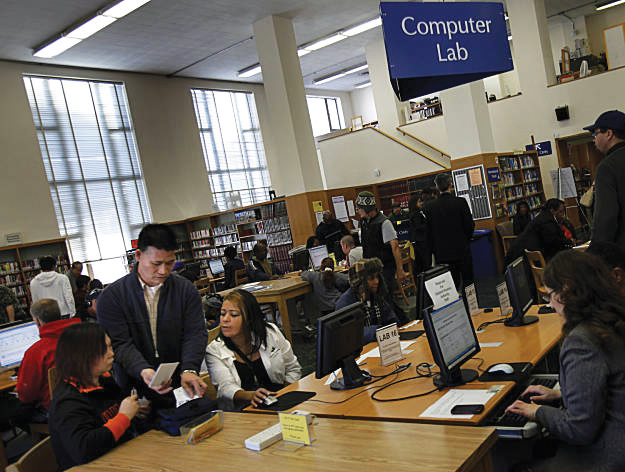 Section-8-applicants-pack-Oakland-Main-Library-012511-by-Brant-Ward-SF-Chronicle, Budget cuts, pathway to homelessness, Local News & Views