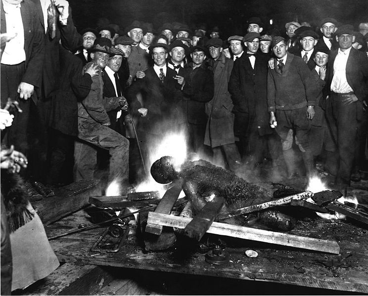 Will-Brown's-lynched-body-burns-downtown-Omaha-1919, The story of the Omaha Two, Behind Enemy Lines