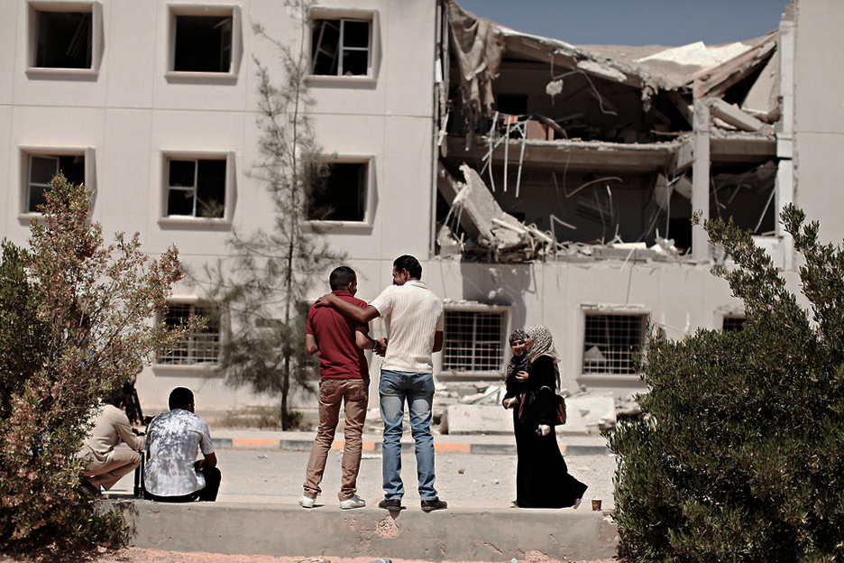 http://sfbayview.com/wp-content/uploads/2011/06/Al-Fatah-University-Geography-Dept.-bldg-partially-destroyed-in-061711-bombing-by-Moises-Saman-NYT.jpg