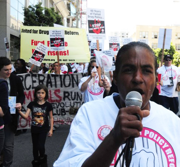 Communities-Rising-to-End-the-Drug-War-and-Mass-Incarceration-300-protest-on-40th-anniv.-of-Nixons-declaration-of-war-on-drugs-at-SF-City-Hall-061711-Shanti-Randles-on-mic-by-Bill-Hackwell1, 'Communities rising' across California to end mass incarceration and the 40-year war on drugs, Behind Enemy Lines