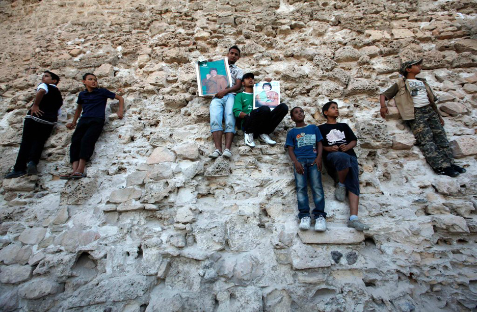 Libyan-youth-Tripoli-protest-NATO-airstrikes-061711-by-Ahmed-Jadallah-Reuters, Facing the bombs of America and NATO in the Libya Jamahiriya, World News & Views