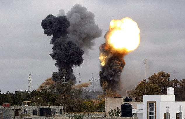 NATO-bombs-Tripoli-051011-by-Mahmud-Turkia-AFP-Getty, African Union threatens withdrawal from United Nations, World News & Views