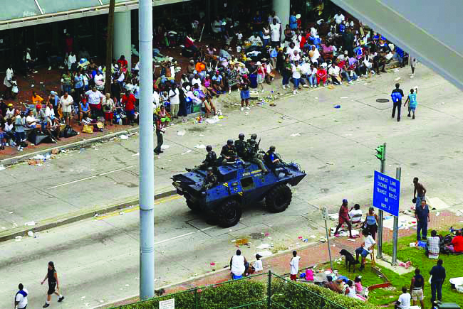 New-Orleans-Katrina-convention-ctr-police-stop-rescue-to-patrol-for-looters-by-MCT4, New Orleans police violence trial begins, National News & Views