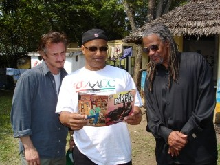 Sean-Penn-visits-Geronimo-ji-Jaga-Pete-ONeal-at-United-African-Alliance-Community-Center-UAACC-in-Imbaseni-Village-Arusha-Tanzania-0719052, Geronimo ji-Jaga: Tributes from Black Panther comrades and current political prisoners, National News & Views
