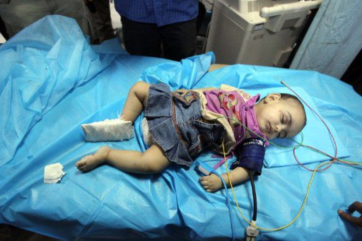 Tripoli-baby-bombing-victim-in-hospital-0611-by-AFP, Neo-neo-colonialism?, World News & Views