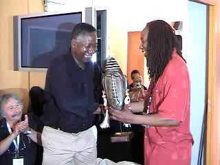 Jacquie-Taliaferro-presents-2007-Sojourner-Truth-Award-to-FESPACO-cofounder-Jean-Marie-Gaston-Kabore, African Diaspora unity at Cannes, Culture Currents