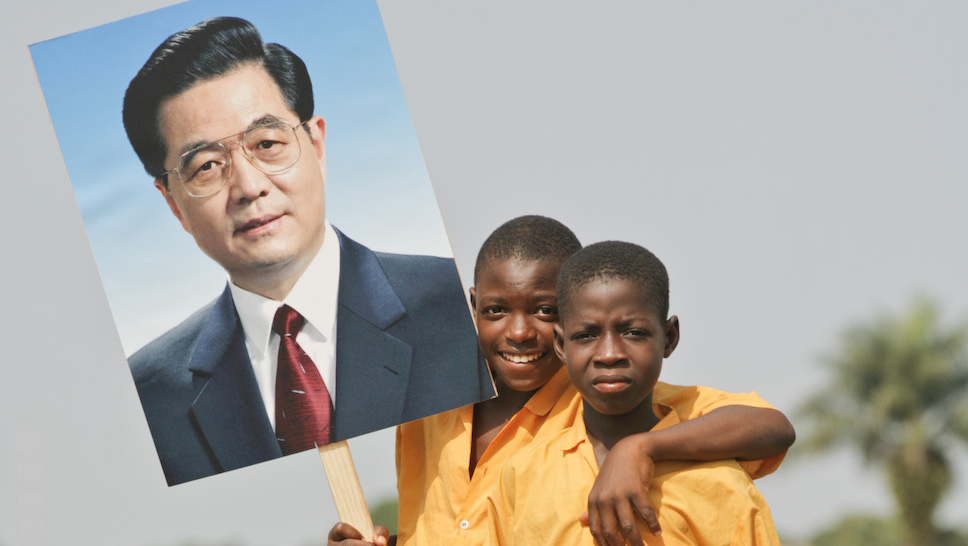 Two-Liberian-boys-holding-picture-of-Chinese-president-Hu-Jintao, A defining moment for Africa: North Atlantic terrorists will be defeated in Libya, World News & Views
