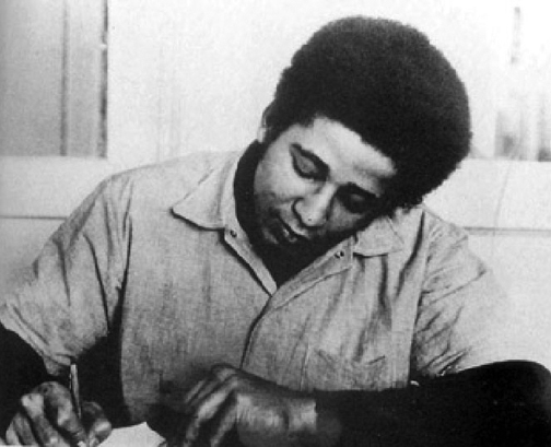 George-Jackson-writing-San-Quentin-web, Commemorating the 40th anniversary of the assassination of Comrade George Jackson, Behind Enemy Lines