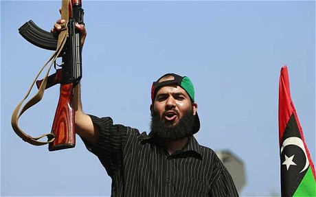 Libyan-rebel-celebrates-in-Tripoli-082211-by-Reuters, Waiting for the endgame in Libya, World News & Views