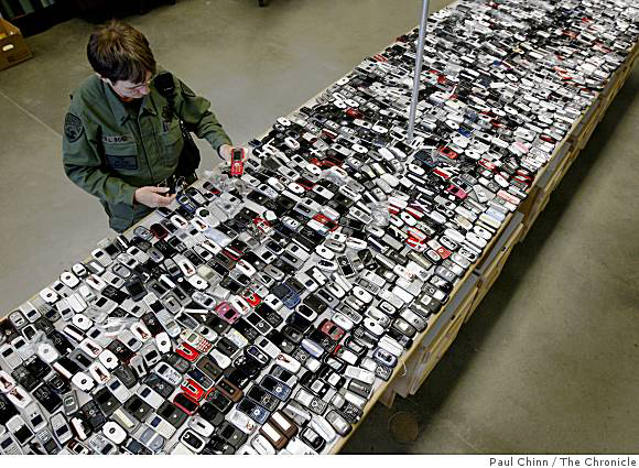 Prisoners-cell-phones-confiscated-at-Vacaville-2006-2009-by-Paul-Chinn-Chron3, Facebook caves to the prison-industrial complex, Behind Enemy Lines