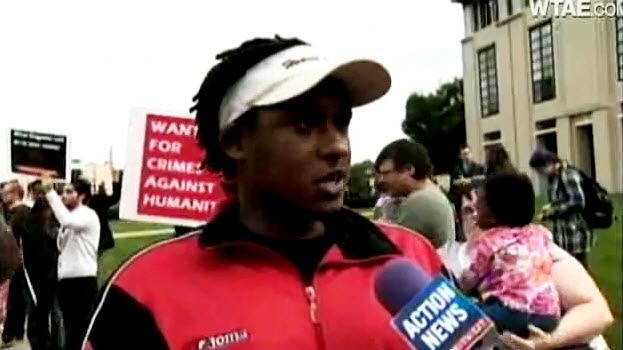 Anti-Kagame-protest-Claude-Gatebuke-leading-Carnegie-Mellon-Univ-091611-by-WTAE-TV-Pittsburgh, Rwandan President Paul Kagame on the night of Troy Davis' execution, World News & Views