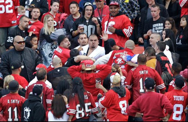 Battle-of-the-Bay-Niners-Raiders-fan-fistfight-Candlestick-stands-082011-by-Ben-Margot-AP, Funk Season 2011: Violence at Niner vs. Raider game mirrors mayhem on Bay streets, Local News & Views