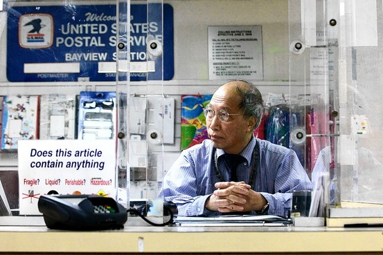 Bayview-Post-Office-clerk-Shun-Wong-in-WSJ-day-after-PO-closures-announced-072711-by-Getty, Save our local post offices … and the entire U.S. Postal Service, National News & Views