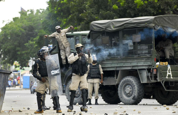 CIMO-UN-police-fire-teargas-at-anti-MINUSTAH-protesters-Champ-de-Mars-PAP-091411-by-Swoan-Parker-Reuters, Marthe Enice Cassandre St. Vil: Haitian family needs our help, World News & Views