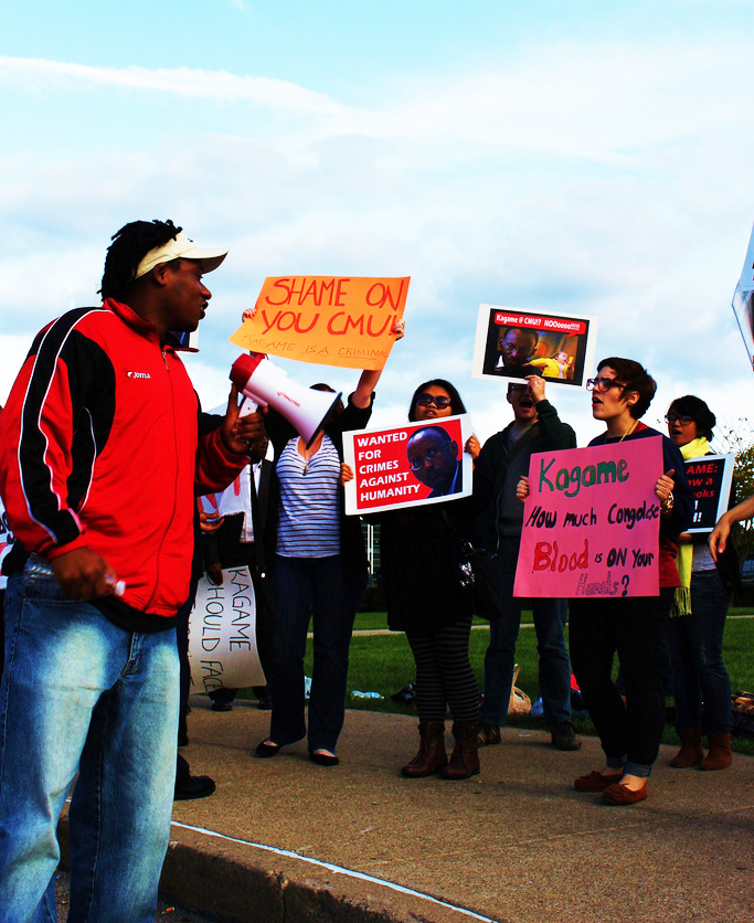 Claude-Gatebuke-students-protest-Kagame-at-Carnegie-Mellon-091611-by-Emily-Russell, Carnegie Mellon professors question university president over planned campus in Kagame's Rwanda, World News & Views