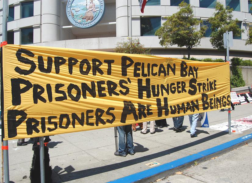 Hunger-strike-solidarity-rally-banner-at-SF-State-Bldg-080111-by-Patricia-Jackson, Greed drives solitary confinement torture, Behind Enemy Lines
