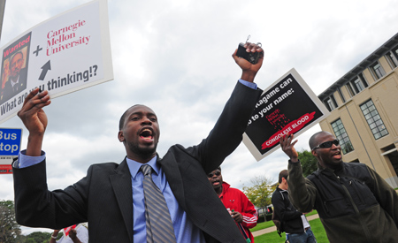 Kambale-protests-Kagame-at-Carnegie-Mellon-091611-by-Andrew-Russell-Pittsburgh-Tribune-Review, Carnegie Mellon professors question university president over planned campus in Kagame's Rwanda, World News & Views
